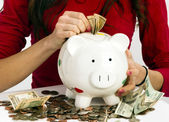Woman Stuffing US Currency Coins Piggy Bank Cash Savings — Stock Photo