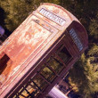 Skewed Vintage Obsolete Outdoor Telephone Booth Southwest Rural  — Stock Photo