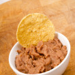 Stock Photo: Corn Chip Buried in Refried Beans Dish Snack Appetizer