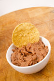 Corn Chip Buried in Refried Beans Dish Snack Appetizer — Stock Photo