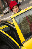 Woman Smiling Wearing Bright Accents Enters Taxi Cab Automobile — Stock Photo