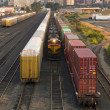 Stock Photo: Railroad Switching Yards Rails Cars Boxcars Engine Locomotive Downtown