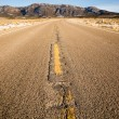Blue Sky Worn Mountain Road Desert Travel Asphalt — Foto de stock #38276337