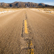 Blue Sky Worn Mountain Road Desert Travel Asphalt — Stock Photo #38276337