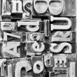 Stock Photo: Metal Type Printing Press Typeset Obsolete Typography Text Letters Sign