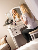 Beautiful Blonde Woman Brushing Hair Bedroom Vanity Natural Beau — 图库照片