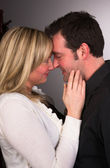 Young Couple Man Woman Engaged Standing Hugging Kissing Embracing — Stock Photo