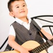 Постер, плакат: Young Boy Jamming Full Size Guitar Gritting Teeth Playing Musician