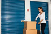 Pretty Woman Moving Cart Full Cardboard Boxes Storage Facility — Stock Photo