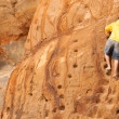 Young Boy Climbs Sandstone Rock Wall Beach Front Male Climber — Stock Photo #47270971