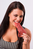 Beautiful Brunette Woman Bites Raw Red Steak Meat Eater — Stock Photo