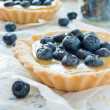 Tartalete with lemon curd and blueberry — Stock Photo