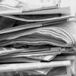 A mess of Newspapers in black and white — Stock Photo