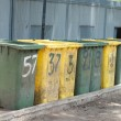 Stock Photo: Row of large bins