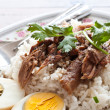 Stock Photo: Pork leg with rice and egg isolated on white