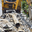 Backhoe digging Asbestos cement pipe. — Stock Photo #32074669