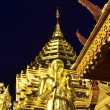 Golden Pagoda and buddhist statue — Stock Photo