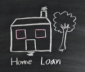 Home loan on blackboard — Stock Photo