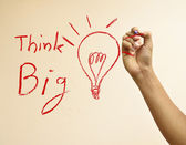 "Hand drawing light bulb and word""Think big"" — Stock Photo"