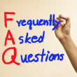 Hand writing FAQ — Stock Photo