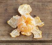 Tangerine on wooden table — Stock fotografie