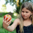 Child eating a red apple — Stock Photo