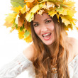 Beautiful fall woman. close up portrait of girl with  autumn wreath of mapl - Stock Photo