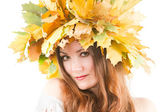 Beautiful fall woman. Portrait of girl with autumn wreath of maple leaves — Stock Photo
