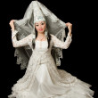 Asian Snow Maiden in national kazakh wedding white dress,  isolated over bl - Stock Photo