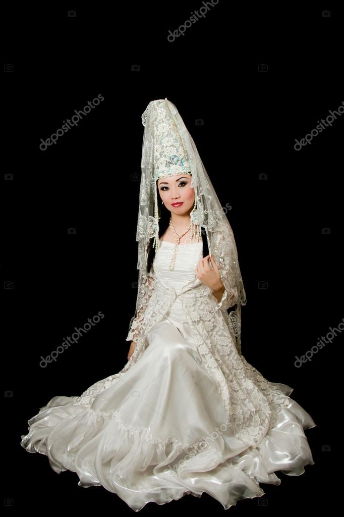 Kazakh bride in national wedding white dress isolated black background — Stock Photo #12530045