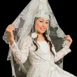 Photo: Kazakh bride in wedding white dress with veil on his face, isolated blac