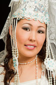 Asian bride in the Kazakh wedding white dress with a veil on his face, isol — Stok fotoğraf