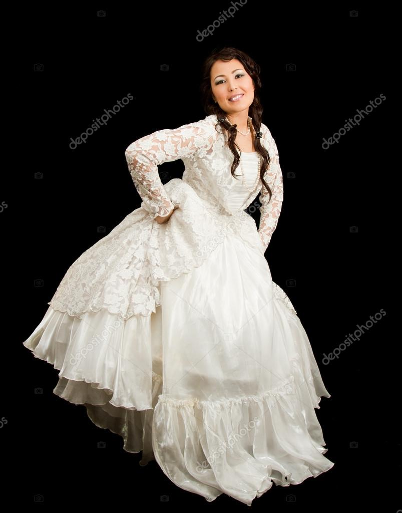 Kazakh bride in national wedding white dress isolated black background — Stock Photo #12563057