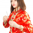 Asian woman in Kimono on a white background — Stock Photo
