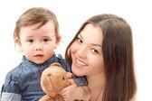 Glad mamma och baby flicka med leksak nalle på vit bakgrund. con — Stockfoto
