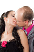Loving couple - husband and wife kissing on a white background — Stock Photo