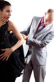 Pareja amorosa - hombre vea debajo falda mujer sobre fondo blanco — Foto de Stock