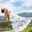 Beautiful woman with long hair meditating on nature of Almaty Young wom — Stock Photo