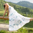 Stock Photo: Beautiful woman with long hair meditating on nature of Almaty Young wom