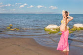 Happy beautiful pregnant woman in swimsuit relaxing at beach The concept — Stock Photo