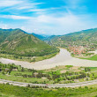 Mountain panorama with green field and blue sky  Summer landscape in mounta - Stock Photo