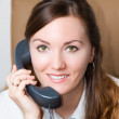 Successful businesswoman talking on the phone at the office .More of this s — Stock Photo #13156230
