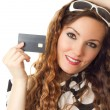 Close-up portrait of young shopping female holding credit card isolated on — Stock Photo