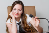Business theme: portrait of successful businesswoman with speakerphone — Stock Photo