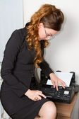 Business theme: beautiful secretary faxing document — Stock Photo
