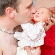 Father and newborn baby daughter cuddling — Stock Photo #14816627