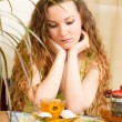 Stock Photo: Portrait of young beautiful womwith teconcept of eating and drinking