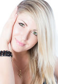 Portrait of a close-up beautiful woman with blondy hair on an isolated white background — Stock Photo