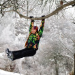 Woman in ski suit on tree in snowy winter outdoors in Kazakhstan — Stock Photo #14920369
