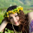 Young beautiful girl laying on the  flowers dandelions, outdoor portrait, summer fun concept — 图库照片